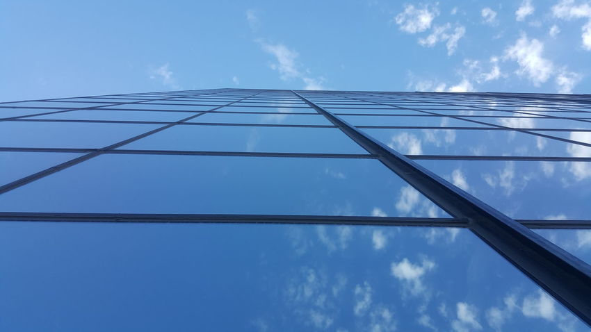 Low Angle View Blue Power Line  Connection Sky Power Supply Cable Fuel And Power Generation Electricity  Cloud Architecture Day Power Cable Building Exterior Repetition Cloud - Sky Office Building Skyscraper Diminishing Perspective Modern Reflect Reflections Reflection Reflection Photography Mirrored Reflection