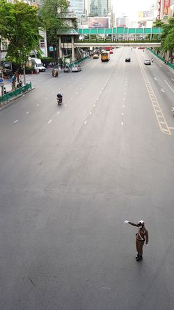 traffic police gets bored Bangkok Traffic Policeman Police Empty Road Rush Hour Street Directing Waving No Traffic City Street From Above  Bird Eye View City Center Wide Road Transport Vehicle Bus Pedestrian Bridge Motorcycle Road City Motor Scooter Street Scene