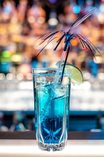 Close-up of azure lemonade cocktail on bar counter