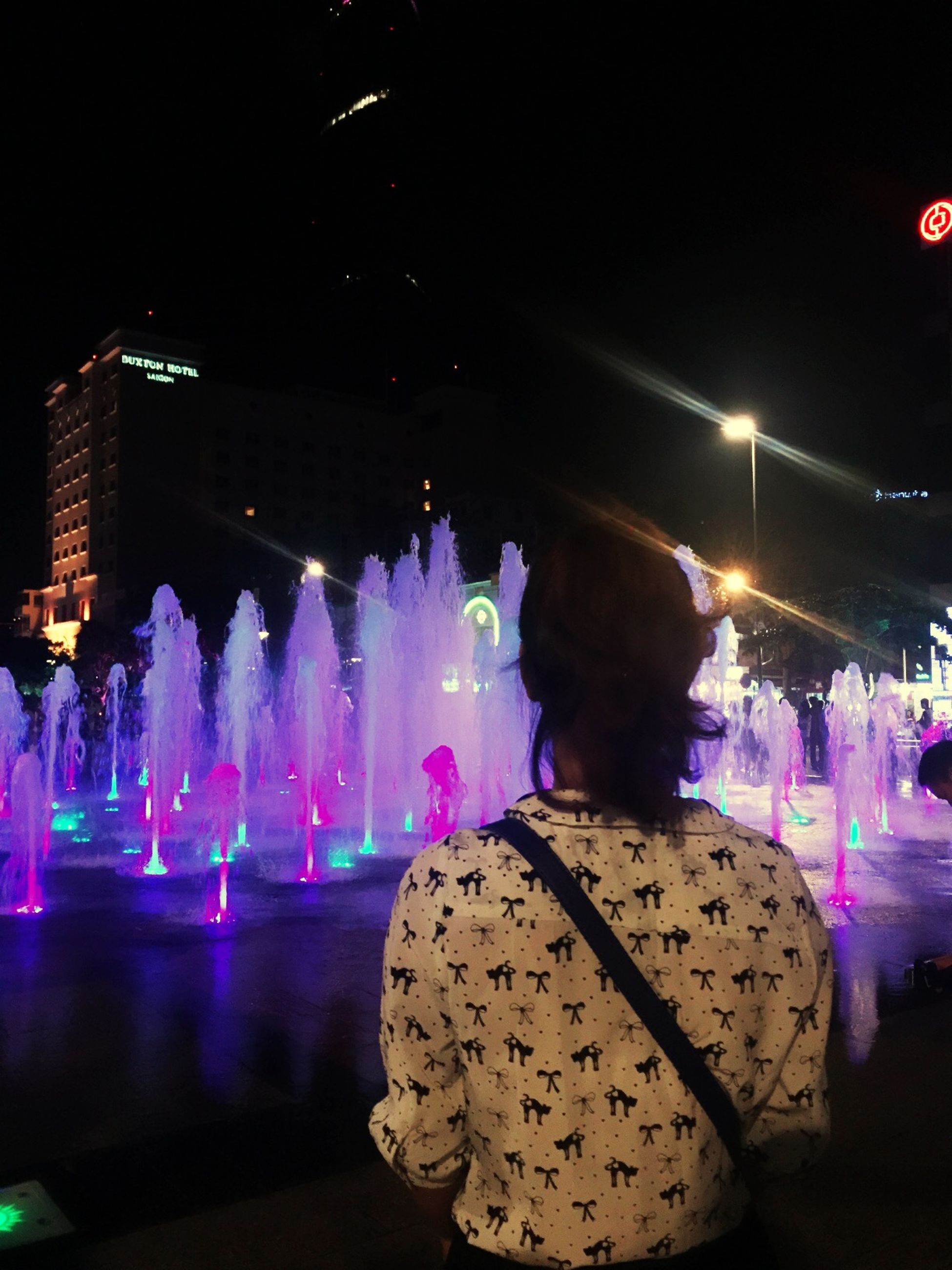 illuminated, night, celebration, long exposure, motion, lifestyles, arts culture and entertainment, leisure activity, blurred motion, enjoyment, event, fountain, light - natural phenomenon, men, performance, smoke - physical structure, glowing, person, nightlife