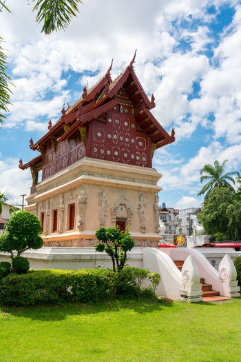 Wat Phra Sing in Chiang Mai Province ,Thailand ASIA Chiang Mai Thailand Wat Phra Sing Wood Architecture Buddhism Building Exterior Built Structure Cloud - Sky Day Grass Landmark Nature No People Outdoors Place Of Worship Religion Sky Temple Travel Destinations Tree