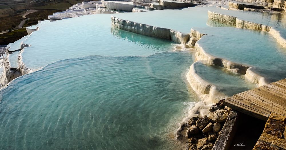 Pamukkale Traverten White Lake Hot Spring History Water Sea High Angle View Beach Beauty In Nature Nature Land Scenics - Nature Sunlight Day No People Motion Outdoors Sport Tranquility Rock Tranquil Scene Wave Aquatic Sport Turquoise Colored My Best Travel Photo EyeEmNewHere