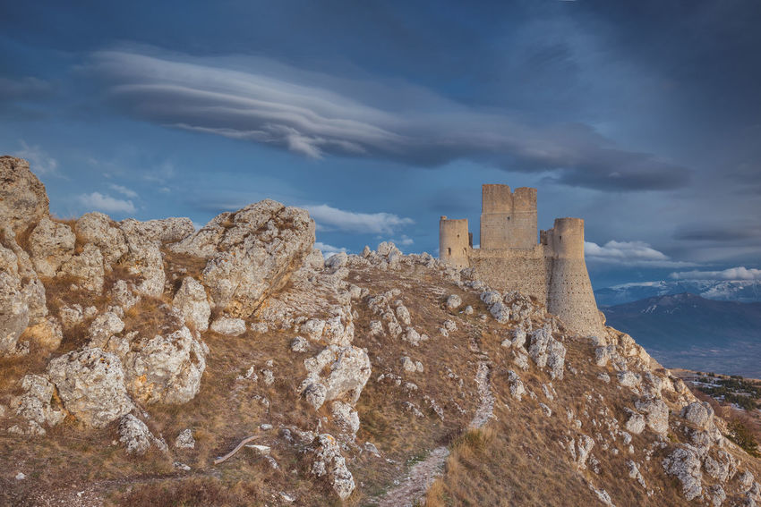 Lenticular clouds over Rocca Calascio Castle EyeEm Best Shots EyeEm Gallery EyeEmNewHere Landscape_Collection Travel Travel Photography Traveling Ancient Architecture Beauty In Nature Built Structure Cloud - Sky Clouds Clouds And Sky History Landscape Mountain Nature No People Old Ruin Outdoors Rock - Object Sky Travel Destinations The Great Outdoors - 2018 EyeEm Awards