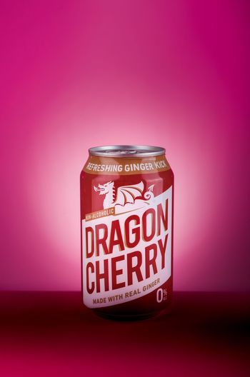 🐉 Brigford Text Indoors  Western Script Single Object Colored Background No People Pink Color Pink Background Studio Shot Close-up Red Table Label Wall - Building Feature Jar Glass - Material Communication Still Life Container Finance