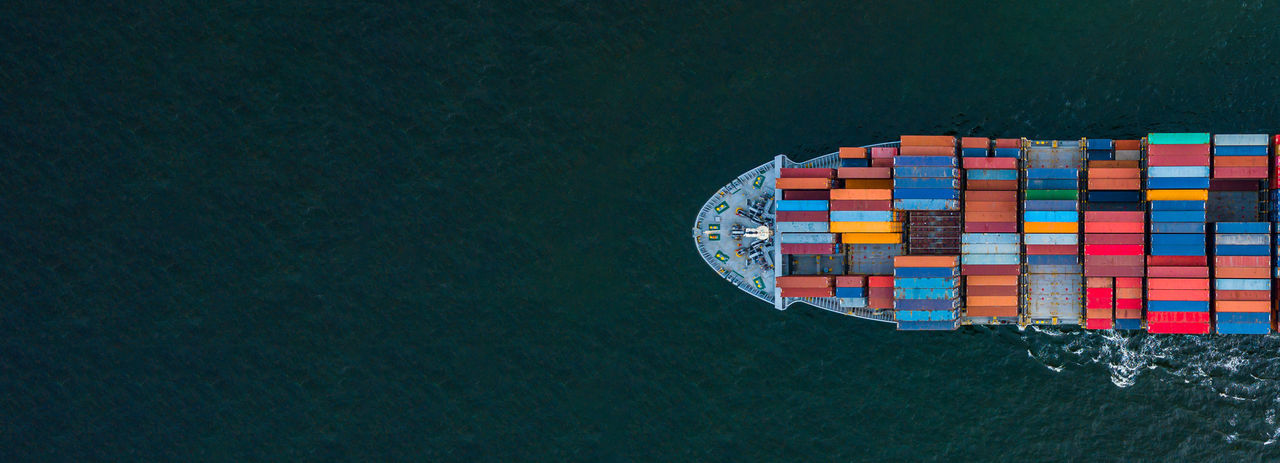 Directly above shot of ship with cargo containers on sea