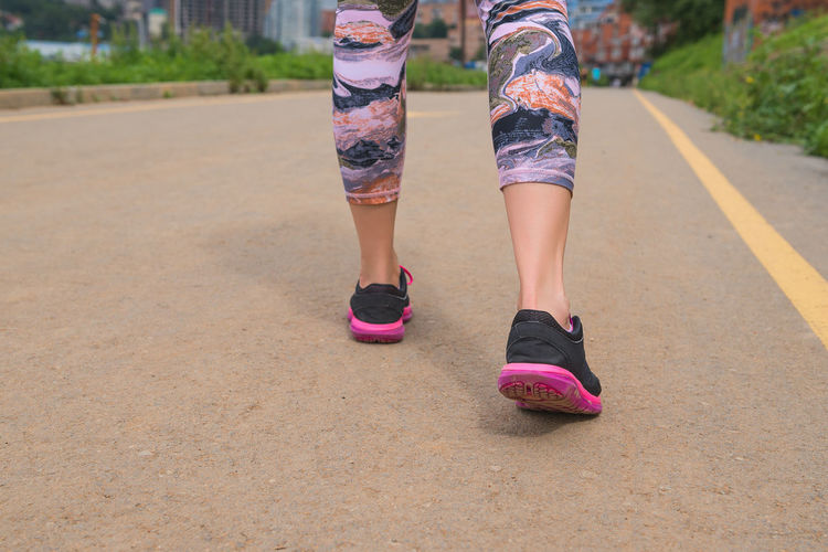 Shoe Low Section Lifestyles One Person Human Leg Real People Day Human Body Part Body Part Leisure Activity Women Roller Skate Nature Pink Color Road Outdoors Street Transportation City Shorts Human Limb