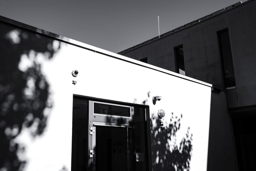 Urban Perspectives The Devil's In The Detail Summer In The City Black & White Monochrome Urban Photography Street Photography Architectural Feature On The Way Sky Architecture Built Structure Building Exterior Closed Door Entryway Architectural Design Architectural Detail Architecture And Art