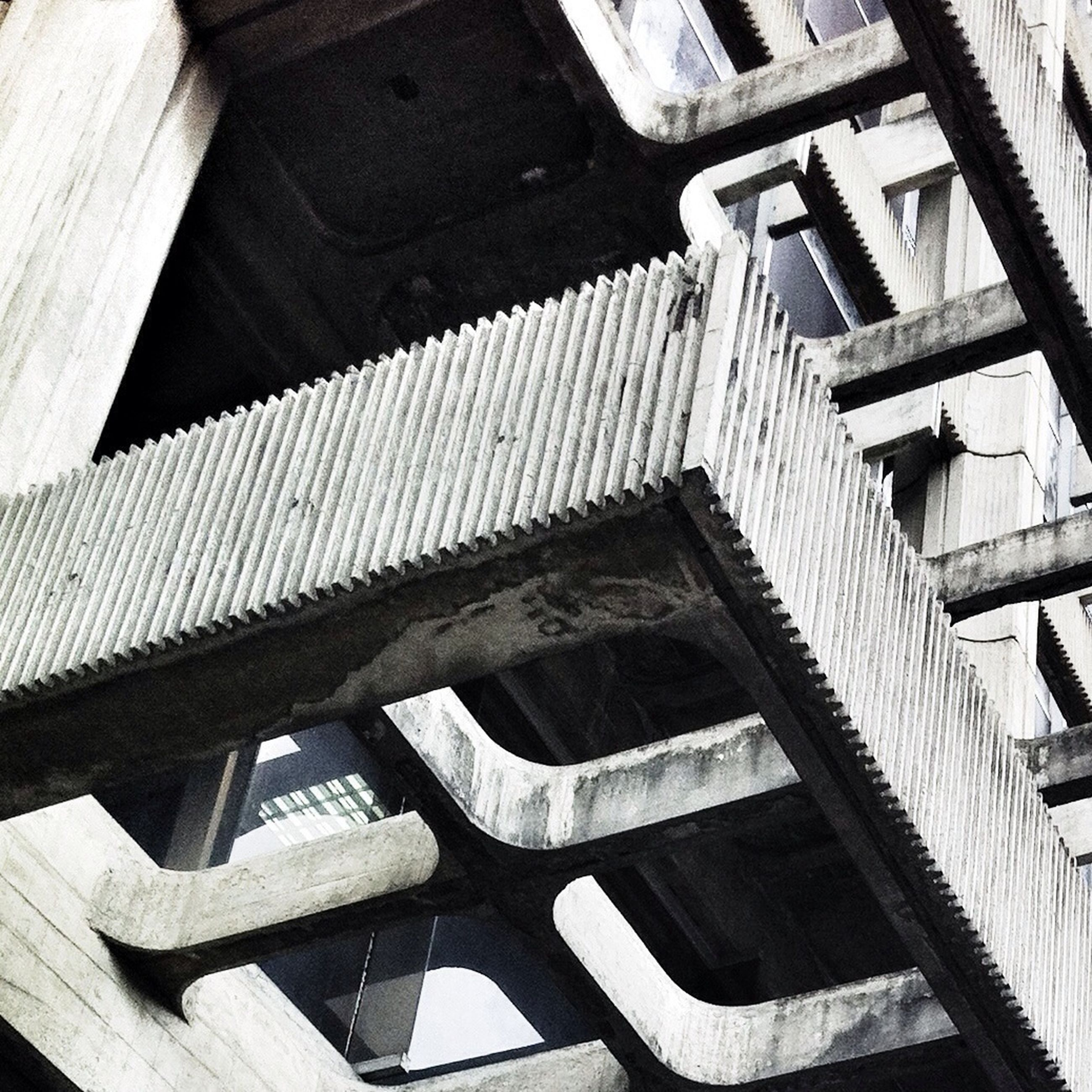 built structure, architecture, staircase, railing, steps and staircases, steps, high angle view, low angle view, building exterior, sunlight, no people, building, stairs, day, connection, outdoors, bridge - man made structure, shadow, metal, pattern