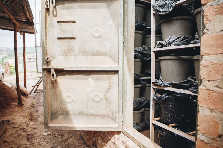 Africa African Built Structure Business Ceramic Clay Day Dirty Drying Entrepreneurship Factory Filter Health Manufacturing Metal Door No People Outdoors Pots Pottery Production Shelves Shelving Social Business Warehouse Water Filter