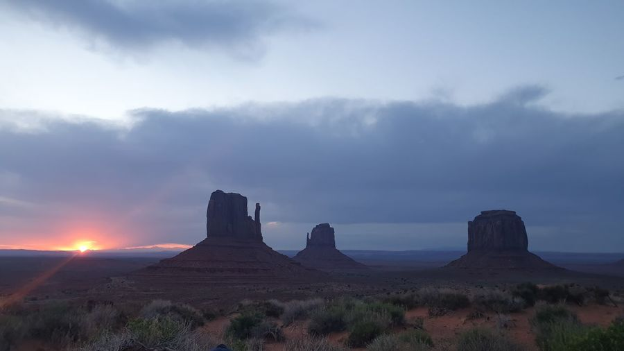 Scenic view of rock formation against sky during sunset