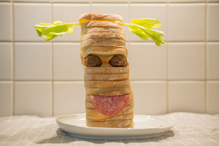 Happy sandwich Abbundance, Bread Close-up Day Face Food Freshness Front View Full Frame Fun Healthy Eating Humor Indoors  Meat Ball No People Plate Salad Salami Sandwich Stacked Studio Shot Tiles