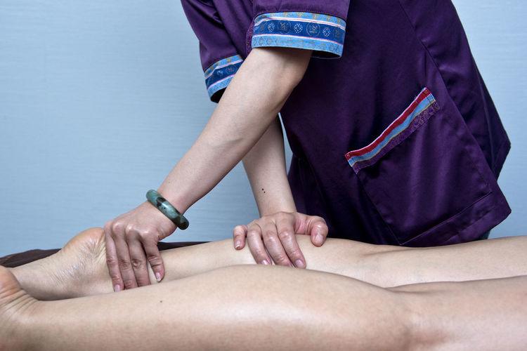 Massage Therapist Massaging Legs