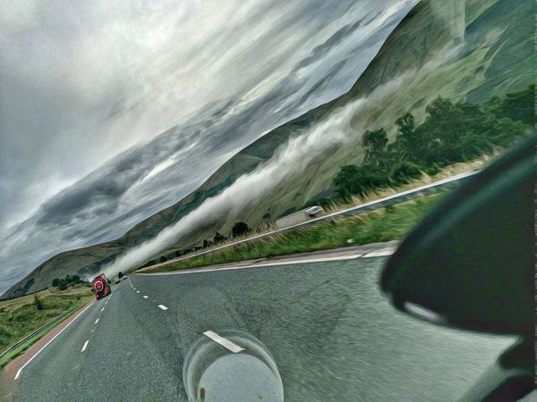 High Clouds Low Mist Road Personal Perspective Mountain Car Speed Cloud - Sky Nature Motion Outdoors Curve Day Scenics Water Human Body Part People Beauty In Nature One Person Sky Lake District