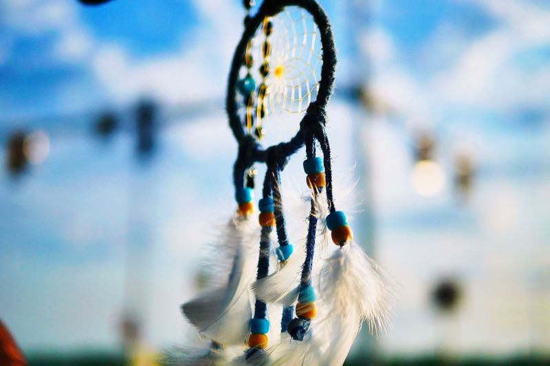 Dream catcher Feather  Close-up Dreamcatcher Focus On Foreground Hanging No People Jewelry Luck Art And Craft Day Blue Craft Craft Product Multi Colored Creativity Outdoors Nature Personal Accessory Sky 10