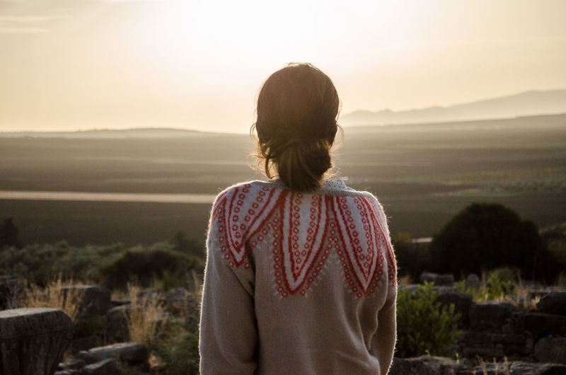 Volubilis Adult Beauty In Nature Casual Clothing Environment Hairstyle Landscape Leisure Activity Lifestyles Looking At View Mountain Nature Non-urban Scene One Person Outdoors Real People Rear View Scenics - Nature Sky Standing Sunset Tranquility Waist Up
