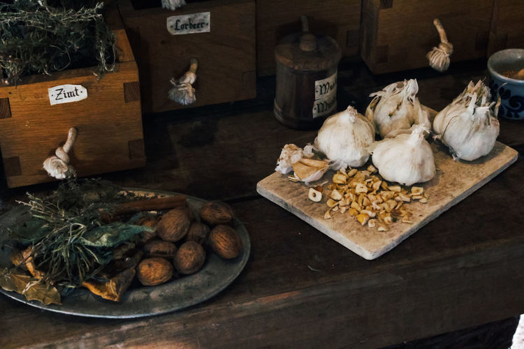 Food And Drink Food Freshness Indoors  No People Choice Variation Still Life Large Group Of Objects Wood - Material Table Wellbeing Healthy Eating Container Vegetable High Angle View Ingredient Raw Food Nut Cutting Board Snack Garlic Medieval Nuts Kitchen Herbs