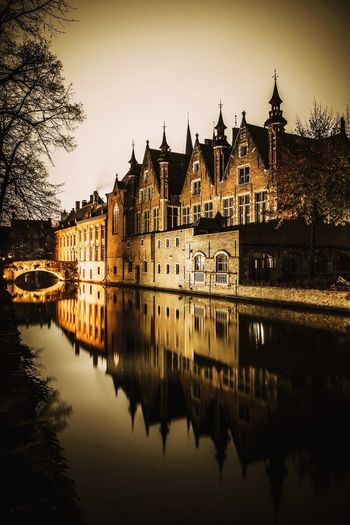 Church reflecting in canal