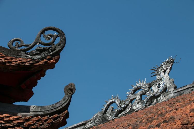 Roof Rooftop Temple Temple - Building Temple Architecture Architecture Asian Culture Backgrounds Background Background Texture Background Photography Sky Sculpture Art And Craft Representation Low Angle View Built Structure Blue Day Clear Sky Creativity No People Outdoors Vietnam Hanoi