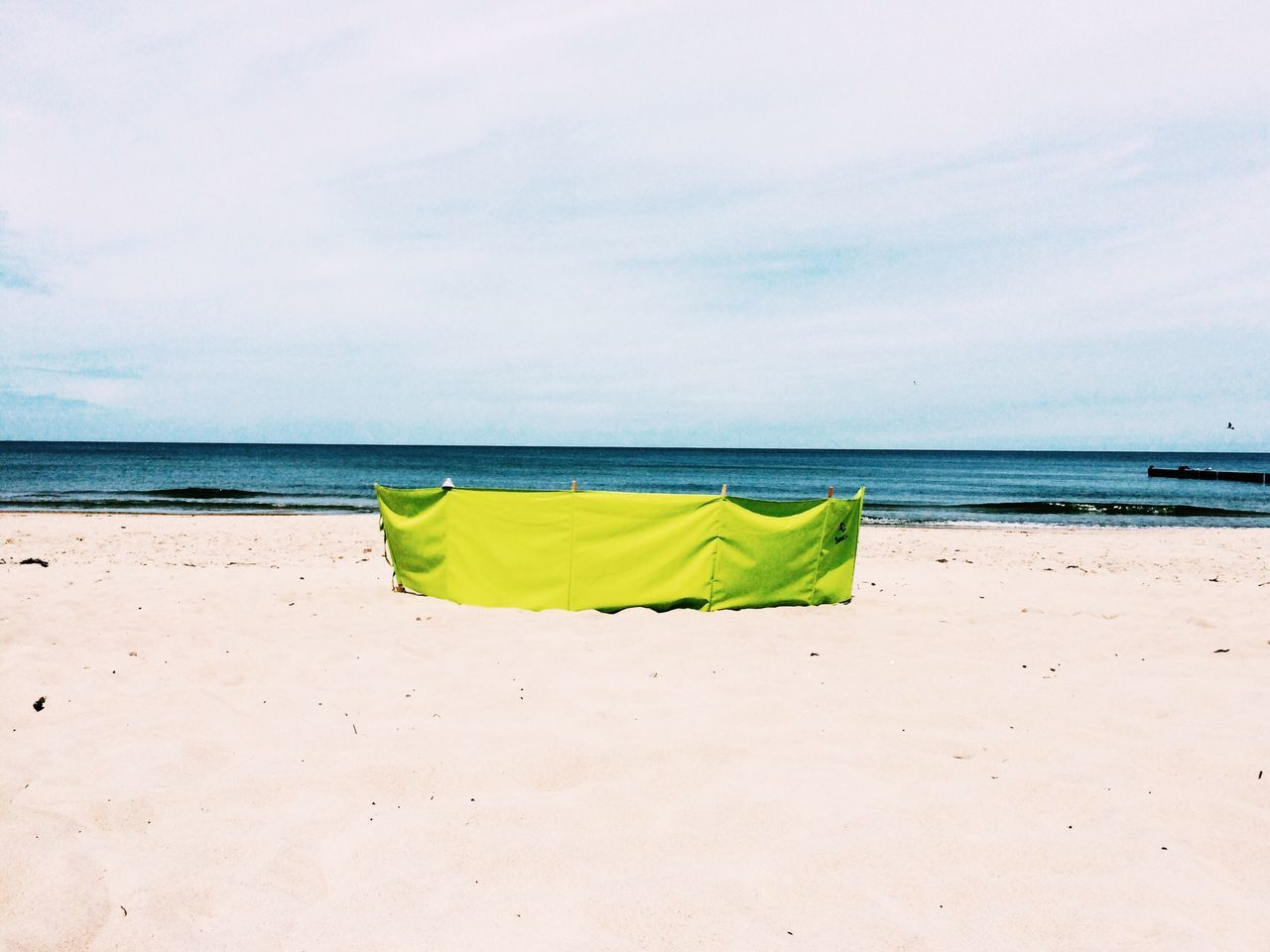 sea, beach, sand, horizon over water, yellow, sky, water, nature, day, green color, no people, tranquility, outdoors, beauty in nature