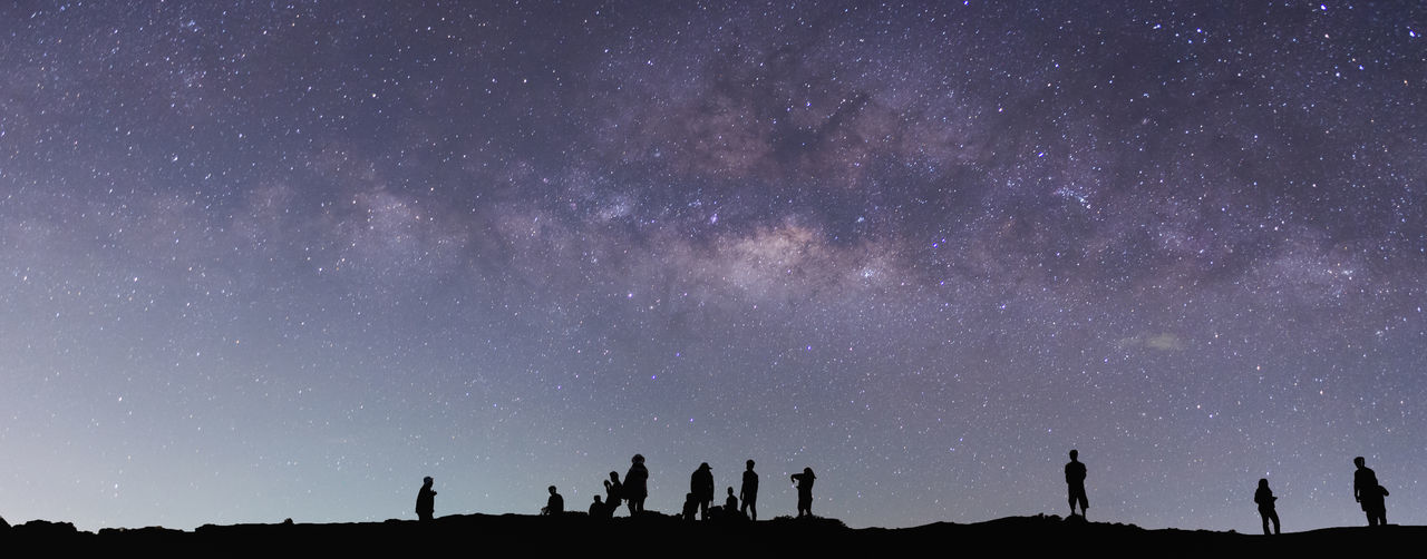 Milky way and people Star - Space Night Space Astronomy Galaxy Sky Scenics - Nature Milky Way Nature Panoramic Constellation Beauty In Nature Silhouette Outdoors People Star Group Of People Science Star Field Landscape