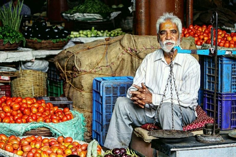 One Man Only Front View Market Stall Market Adults Only Adult Senior Adult Food And Drink People One Person Food Only Men Fruit Healthy Eating Outdoors Men Real People Business Freshness Sitting