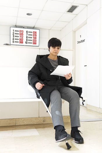 hospital waiting room with injury woman in medical appointment Waiting Room Waiting Rooms Hospital Hospital Room Woman Injury Appointment Care Interior Patient Service Receptionist Waitress Nurse Doctor  Health Medical Visiting Clinic Consultation Professional Reading