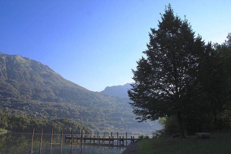 Lake Lake Mountain Railing Mountain Range Tree Scenics Nature Tranquil Scene