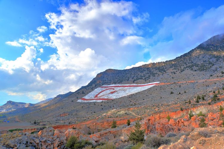 the biggest flag in the world that can be seen from space in north cyprus Beauty In Nature Biggestflag Cloud - Sky Day Flag Geology Landscape Mountain Nature No People North Cyprus Outdoors Scenics Sky