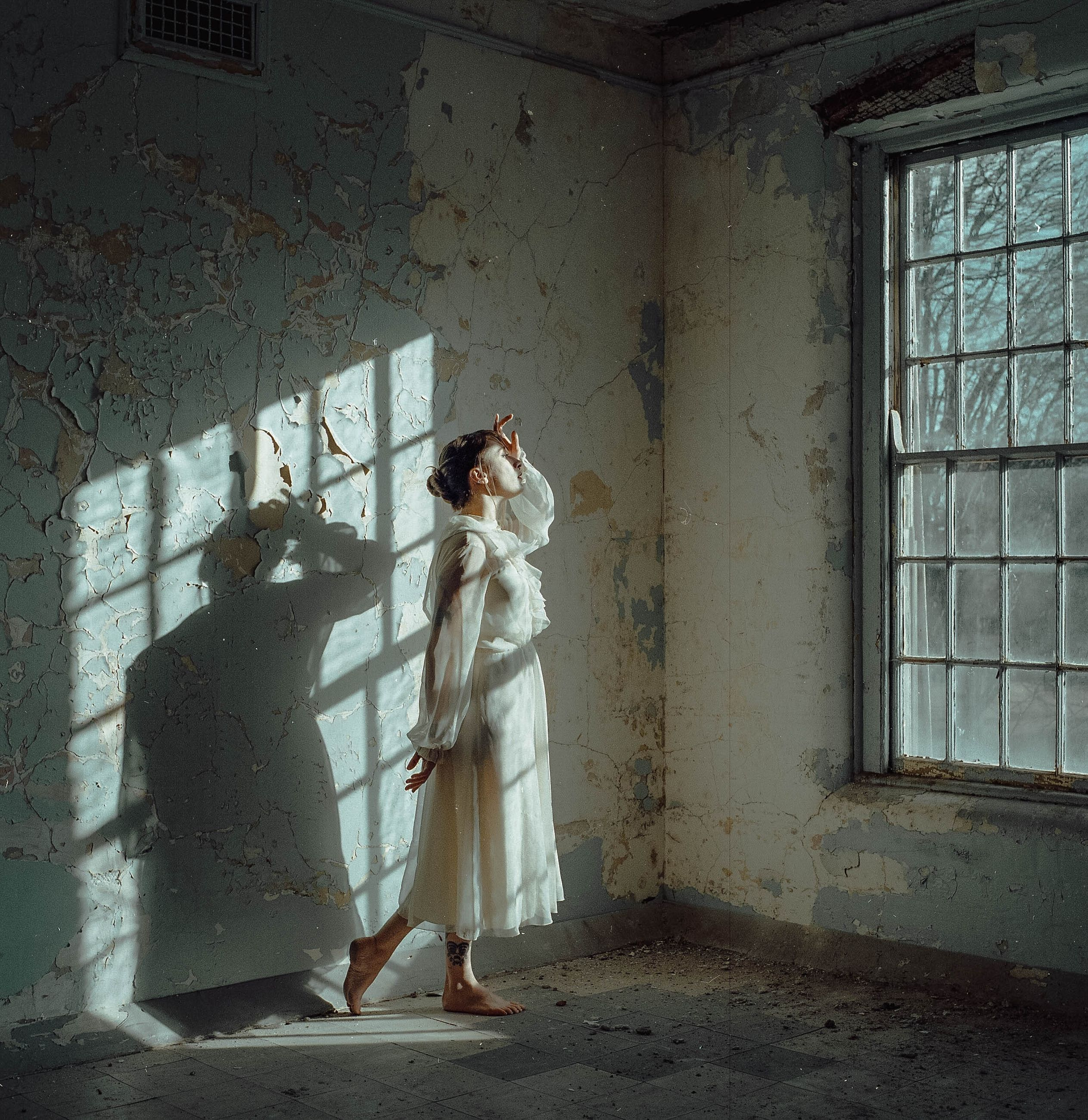 women, indoors, real people, full length, standing, adult, wall - building feature, abandoned, architecture, window, sunlight, built structure, day, people, lifestyles, leisure activity, two people, clothing, men, building, deterioration