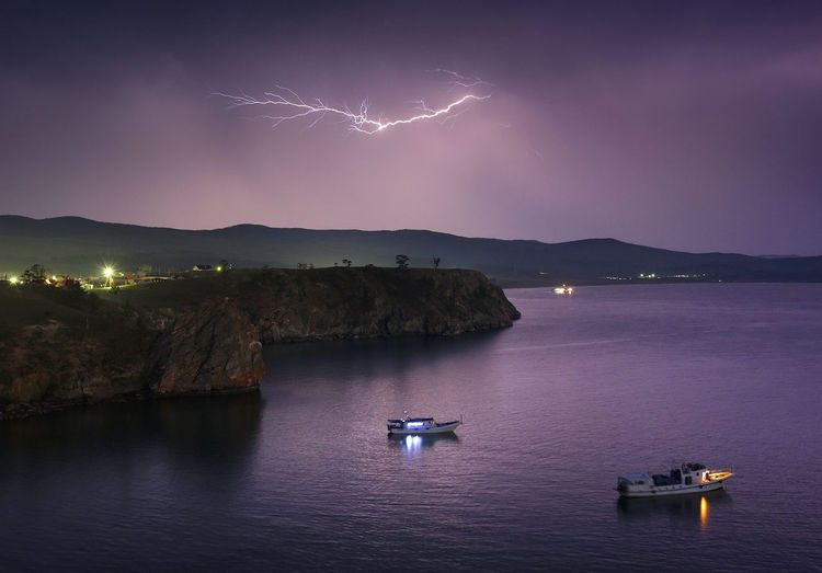 Nikon D750, Nikkor 28-300mm f 3,5-5,6 VR ED Baikal Beauty In Nature Boat Dramatic Sky Illuminated Lightning Majestic Mountain Mountain Range Nature Nautical Vessel Outdoors Remote Russia Scenics Sea Siberia Sky Storm Storm Cloud Tranquil Scene Tranquility Transportation Water Waterfront