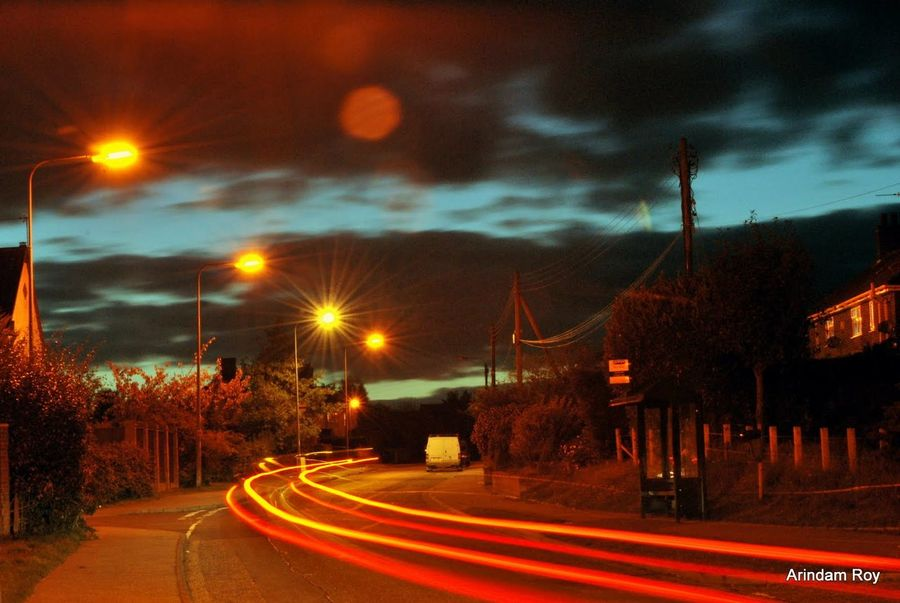 Blurred Motion Building Exterior City Cloud - Sky Empty Road Illuminated Light Trail Lighting Equipment Long Exposure Motion Night Outdoors Red Road Rush Hour Sky Speed Street Street Light Tail Light The Way Forward Transportation Vehicle Light