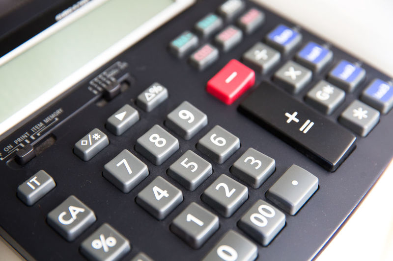 Technology Number Calculator Business Finance Mathematics Close-up Plus Sign Symbol Text Education Corporate Business People Indoors  Accuracy Single Object Electronics Industry Industry Keypad Push Button Computer Key Calculating Blurred Background