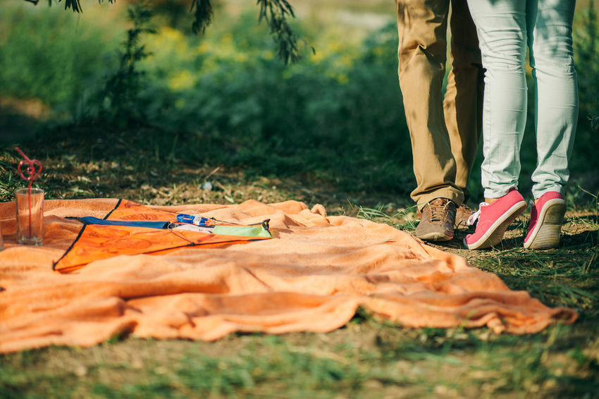 couple dating romantic picnic together. Summer picnic time. Man and woman on first date. Couple Dating EyeEm Best Shots EyeEm Gallery Green Happiness Joyful K Love Love Story Man Picnic Romantic Stylish Summertime Couple - Relationship Forest Joy Kissing Meadow Picnic Table Picnic Time ♡ Summer Water