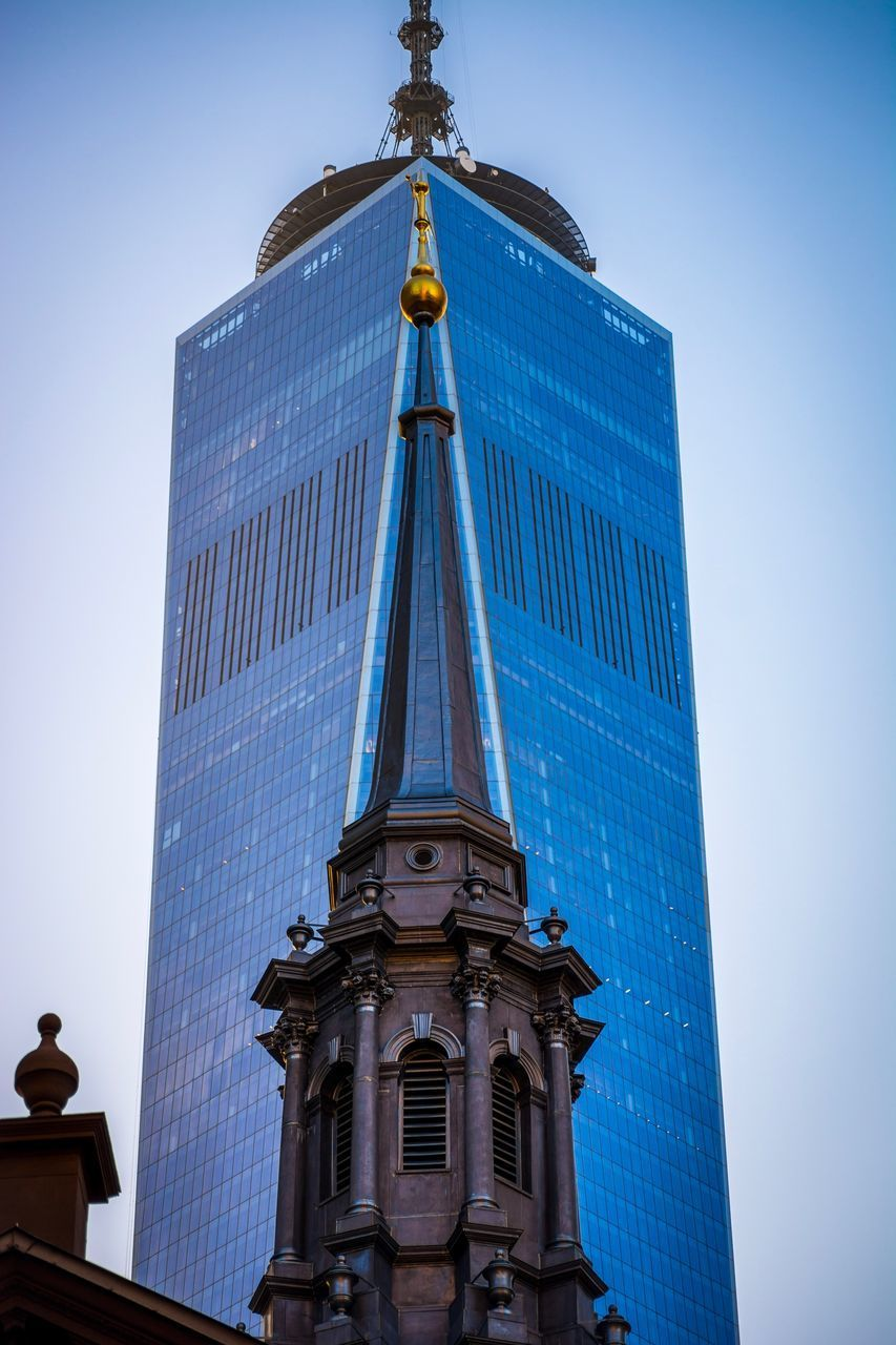 architecture, built structure, low angle view, building exterior, sky, building, tower, tall - high, blue, city, no people, office building exterior, nature, day, travel destinations, clear sky, lighting equipment, skyscraper, outdoors, clock, spire