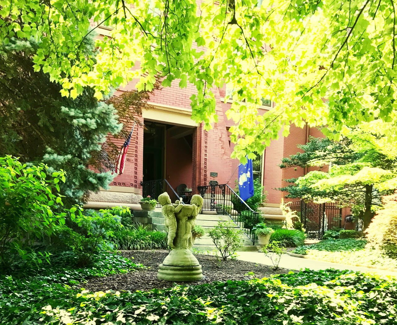 statue, architecture, tree, growth, day, built structure, no people, plant, building exterior, grass, sculpture, outdoors, green color, sunlight, nature, beauty in nature