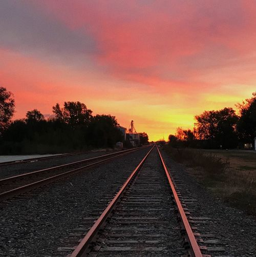 i am new to this app but i am really interested in photography Sunset Sky Railroad Track Tree Diminishing Perspective The Way Forward Landscape Nature Outdoors Beauty In Nature First Eyeem Photo