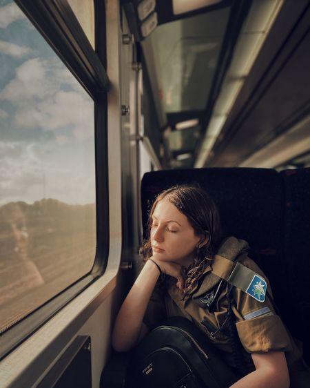 Man looking through train window