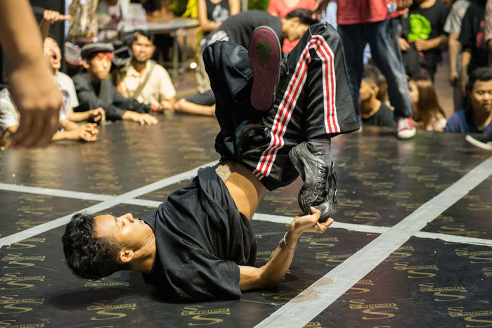 B-BOY Bangkok Boys Casual Clothing Cultures Dancing Focus On Foreground Full Length Large Group Of People Leisure Activity Lifestyles Medium Group Of People Men Outdoors Person Rear View Sitting Standing Thailand Togetherness Traditional Clothing Water