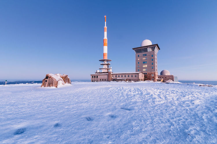 Snow Built Structure Cold Temperature Sky Architecture Tower Winter Building Exterior Nature Clear Sky Building Blue No People Day Travel Covering Land Outdoors Lighthouse Global Communications Harz Harzmountains Winter Wintertime
