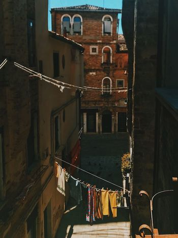 sunny days all Venice is smelling fresh EyeEmNewHere Neighborhood Mywindowview Outofwindow Narrow Street Venezia Italia Venezia Venice, Italy Cleaningday Rope Washingclothes Building Exterior Built Structure Architecture Building City Window Night Outdoors Nature Street