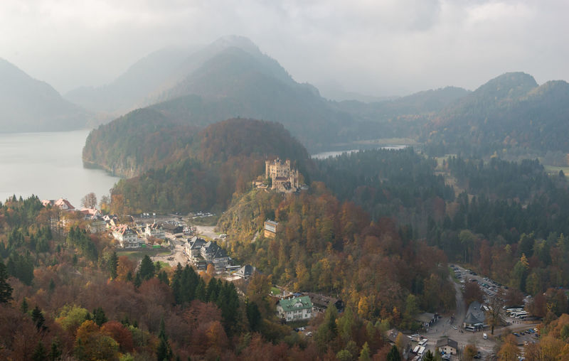 Hohenschwangau Castle with Autumn colors, Fussen, Germany Mountain Tree Scenics - Nature Plant Beauty In Nature Tranquil Scene Nature Sky Tranquility Day Water No People Non-urban Scene Mountain Range Autumn High Angle View Change Architecture Environment Outdoors
