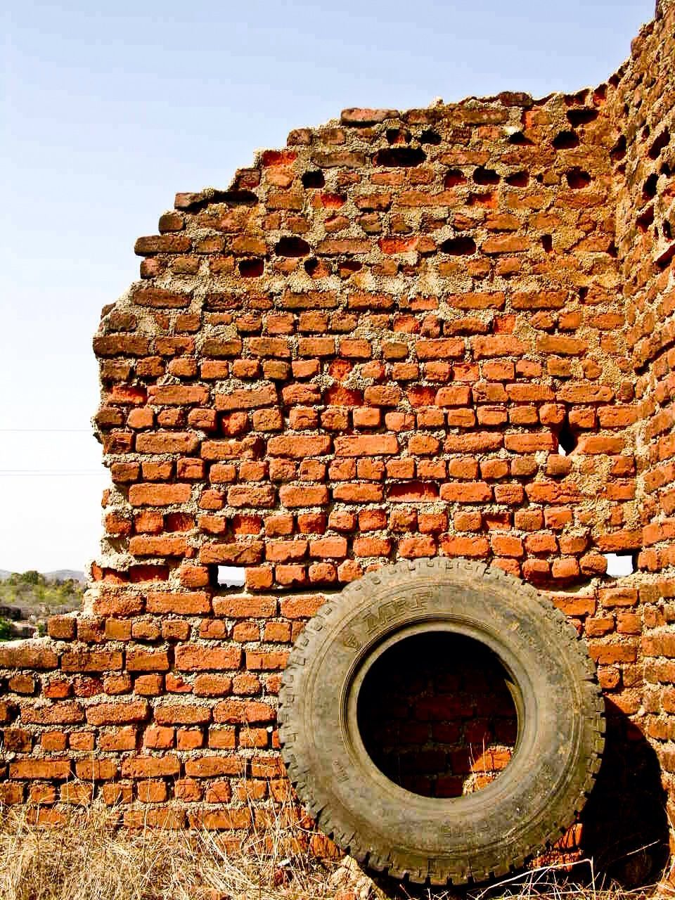 brick wall, architecture, built structure, history, building exterior, no people, day, outdoors, red, low angle view, sky