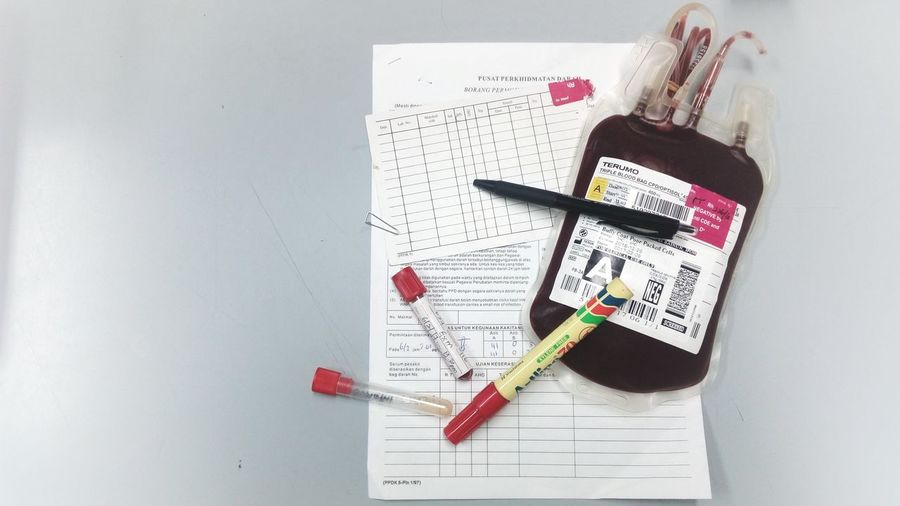 High view - patient's sample and blood bag. Live Hospital Medical Equipment Human Blood Human Blood Is One Color Blood Bag Pint Save Lives Packed Cell Red Blood Crossmatching Medical Blood Bankers Blood Donation Blood Bank Blood Transfusion Red Transfusion Blood Rhesus Negative Close-up Blood Donor