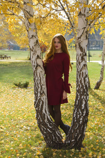 Autumn One Person Only Women Tree Adult Adults Only One Woman Only Grass People Nature Standing Smiling Young Adult Portrait Outdoors Happiness Young Women Day Women Leaf