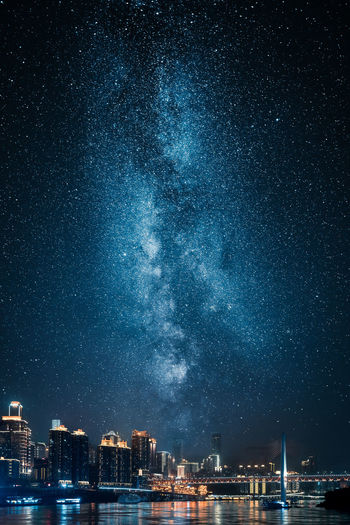 View of milky way over city at night