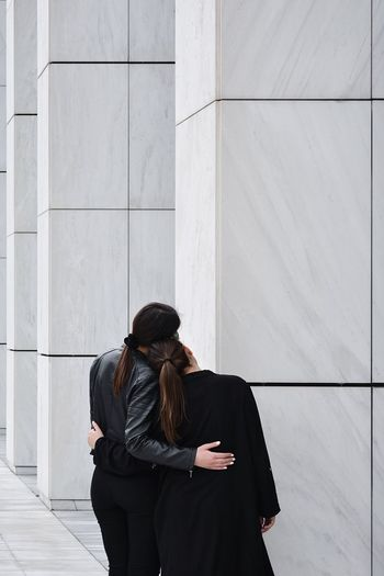 I got you Minimalist Architecture Architecture Minimalist Minimal Eye4photography  EyeEm Best Shots The Week Of Eyeem The Week on EyeEm Sister Sisterhood Union Simple Photography Simplicity Twins Real People Architecture Women Built Structure Three Quarter Length Standing Building Exterior Wall - Building Feature Black Color Communication Outdoors 50 Ways Of Seeing: Gratitude