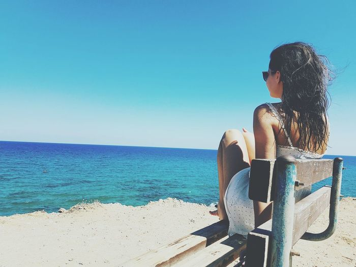 Sea Clear Sky Sitting Relaxation Blue Only Women Beach Water SunnySky Horizon Over Water Looking At View One Woman Only One Person Outdoors Casual Clothing Sunlight