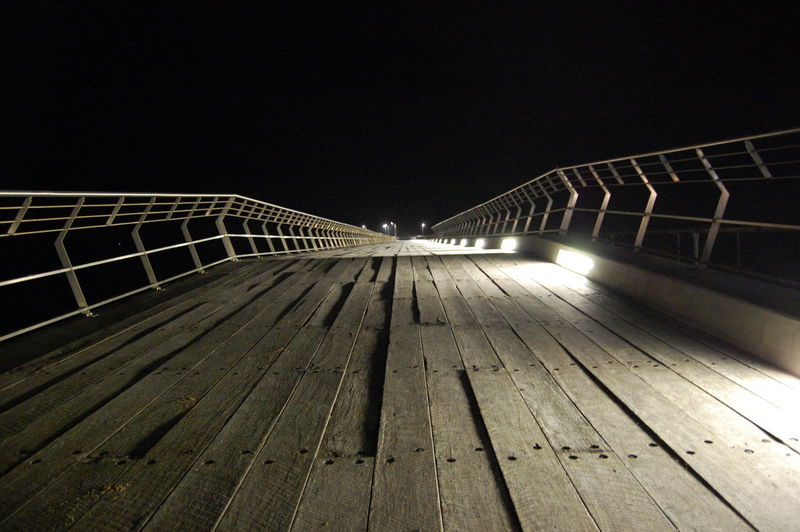 Pier at night. Night Architecture Built Structure Illuminated Railing The Way Forward Direction Wood - Material Sky No People Nature Bridge Clear Sky Footpath Copy Space Outdoors Diminishing Perspective Empty Pier Bridge - Man Made Structure