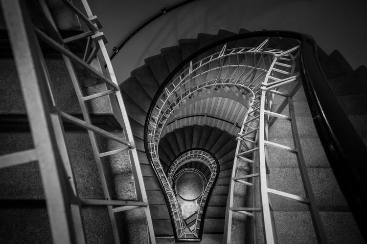 The Downward Spiral Architecture B&w Blackandwhite Built Structure Capital Cities  City Cubism Cubist Czech Republic Downwards Europe Interior Interior Views Looking Down Mono Monochrome No People Perspective Prague Railing Spiral Spiral Staircase Staircase Steps Steps And Staircases