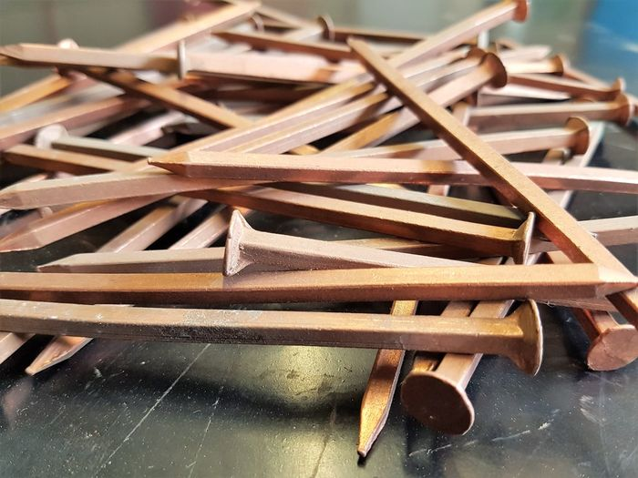 Copper nails used in traditional ship repairs Boat Repair And Restoration Nails Wooden Boat Carpentry Close-up Copper  Handbuilt Macro Nautical Vessel Old School Boat Ship Repair Shipwright Shipyard Vintage Boat Wooden Boats Wooden Vessel Woodworking